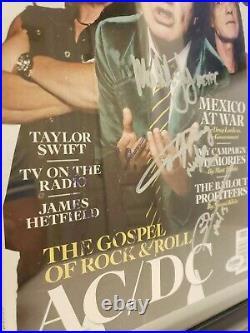 Autographed ACDC Rolling Stone Magazine. 4/PSA