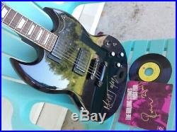 ROLLING STONES MICK JAGGER autograph guitare STORM signed live ep RON WOOD rare
