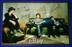 Rolling Stones Autographed 11x17 Photo COA Mick Jagger Keith Richards